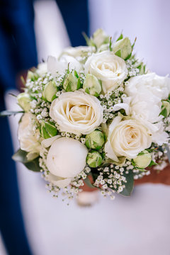 Close-up of bouquet on table at wedding ceremony