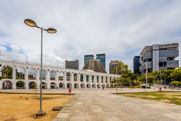 Carioca Aqueduct with Cathedral of Saint Sebastian and modern business buildings in the background, Rio De Janeiro, Brazil