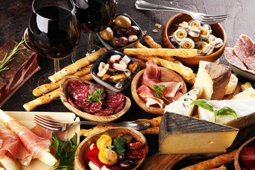 Italian antipasti wine snacks set. Cheese variety, Mediterranean olives, seafood salad, Prosciutto...
