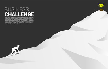 silhouette of businessman ready to run to trophy at top of mountain. Concept of vision mission and goal of business Wall mural