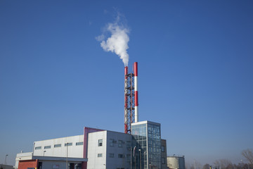 Heating plant - powerhouse and chimey with smoke