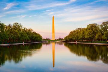 The Washington Monument and Reflection Pool in Washington DC at sunset