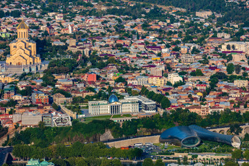 Fototapete - cityscape skyline of downtown Tbilisi with Holy Trinity Cathedral Georgia capital city eastern Europe