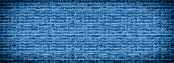 Panoramic background of wide old Classic blue color of the year 2020 brick wall texture. Home or...