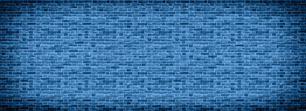Panoramic background of wide old Classic blue color of the year 2020 brick wall texture. Home or office design backdrop