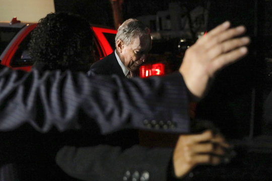 Democratic U.S. presidential candidate Michael Bloomberg exits after delivering remarks where he was honored by the Iron Hills Civic Association at the Richmond County Country Club in Staten Island, New York