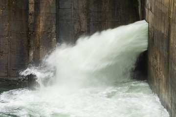 Spoed Fotobehang Bos rivier A Powerful Man-Made Waterfall Providing Water to the City Inhabitants