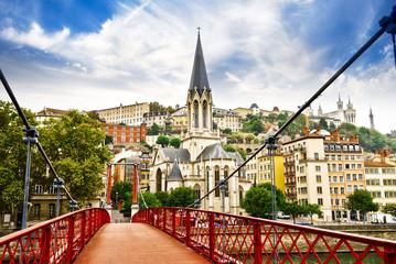 Pedestrian Saint Georges footbridge and the Saint Georges church in Lyon, France