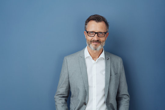 Smiling friendly professional man wearing glasses