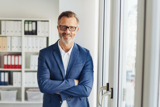 Confident stylish businessman with friendly smile