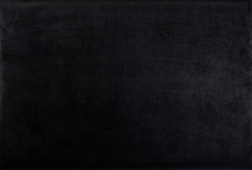 Black color velvet texture. Dark background. Top view.