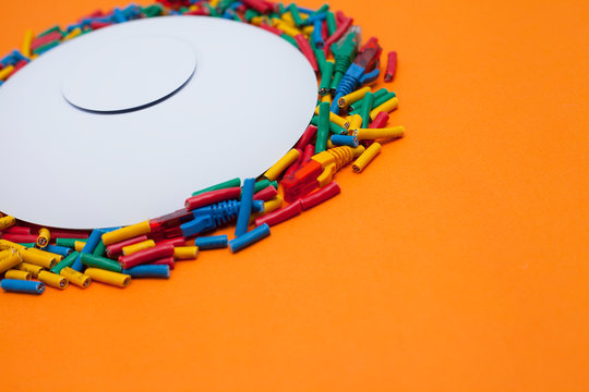 Access point with bright cables connected on it on the orange background. Space for your text.
