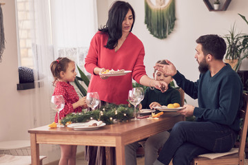 Family Together Christmas Celebration Concept. Family Enjoying christmas dinner background