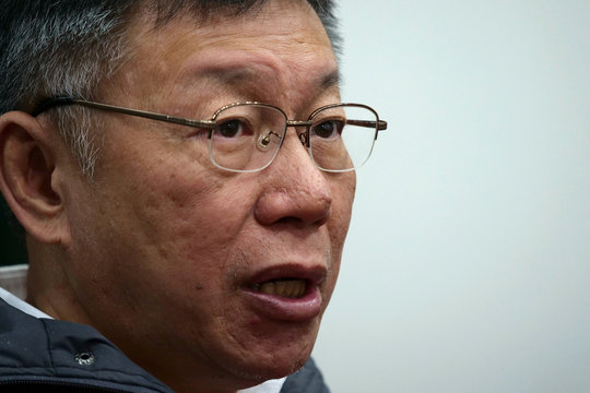 Taipei Mayor Ko Wen-je speaks during an interview with Reuters in his office at the Taipei City Hall