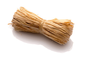Roll of natural raffia on a white background