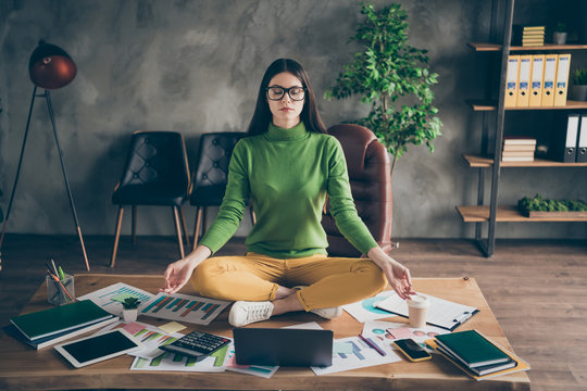 Portrait of her she nice attractive experienced professional girl agent broker meditating training self developing chakra asana energy at modern loft industrial interior work place station