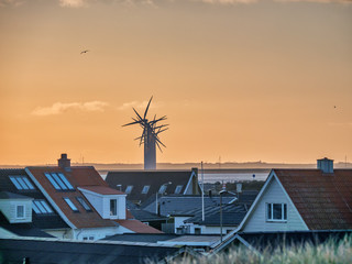 Thyboroen village at sunrise  with windfarm, Denmark