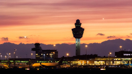 Amsterdam Schiphol International Airport while planes are landing after sunset on January 9, 2019