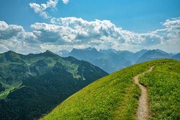 Beautiful summer hike on mountain ridge from Klingenstock to Fronalpstock peak above the village of Stoos