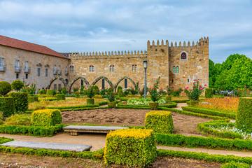 Archbishop palace viewed through gardens of Santa Barbara in Braga, Portugal