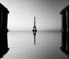 The beginning of the end, climate change , Artistic black and white photograph of the Famous places in Paris, France, flooded by the rising sea,