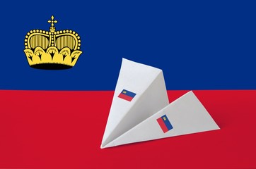 Obraz Liechtenstein flag depicted on paper origami airplane. Handmade arts concept - fototapety do salonu
