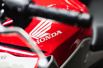 Bangkok, Thailand - Decemeber 5, 2019 : Honda  logo on the body of sports motorbike at a car show. Honda is a one of the famous manufacture of automobiles, motorcycles and power equipment.
