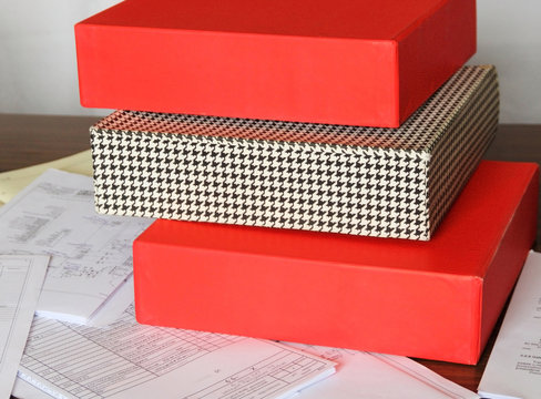 Red, checkered folders for documents with schemes on the table
