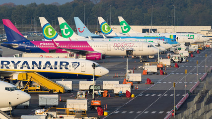 Various low-budget airline aircraft parked at the terminal of Eindhoven-Airport on October 25, 2017