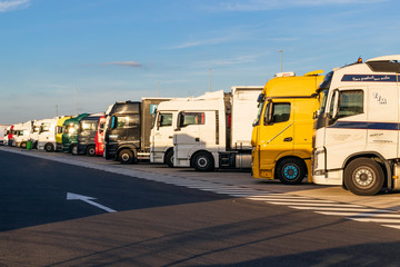 Row of trucks on a truck overnight parking along the E17 highway in Belgium on June 23, 2017