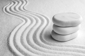Photo sur Plexiglas Zen pierres a sable Stack of white stones on sand with pattern, space for text. Zen, meditation, harmony