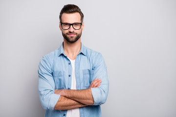 Photo of positive business guy young boss chief hands crossed self-confident person friendly smiling colleagues partners wear specs casual denim outfit isolated grey color background