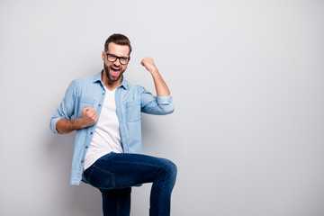 Photo of attractive wild crazy business guy excited emotions successful startup project investment raising fists wear specs casual denim outfit isolated grey color background