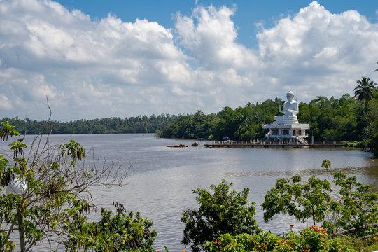 Bentota, Sri Lanka - The Benthara Buddha Statue, a large white religious figure, sits on the banks of the Bentota River
