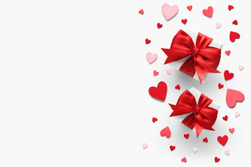 Valentines day romantic background - gifts with red bows and hearts