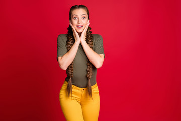 Photo of amazing lady long braids holding arms on cheekbones listen good news final season discounts wear casual yellow pants green t-shirt isolated red color background