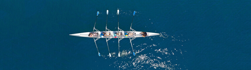 Aerial drone top panoramic view of sport canoe rowing synchronous athletes competing in tropical exotic lake Fototapete