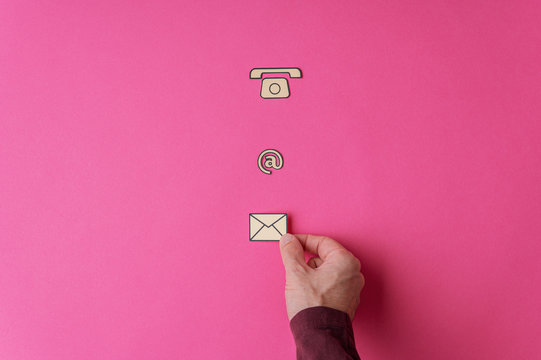 Placing contact and communication icons on pink background
