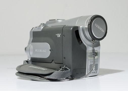 london, england, 05/05/2019 A samsung mini dv digital camcorder dig cam recorder. SAMSUNG VP-D93 Mini DV/800 x Zoom LCD Digital Camcorder silver isolated on white studio backdrop.