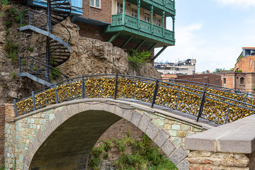 Arched bridge of lovers, hung with gilded Love locks of the newlyweds and lovers