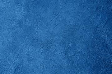 Deep blue textured concrete dark background. Color of 2020 trendy monochrome mockup backdrop