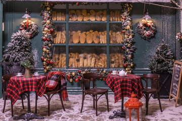 Bakery Street cafe. winter and snow. Christmas decorations. checkered plaid on a chair