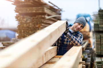 Fototapeta Young male worker in timber warehouse  obraz