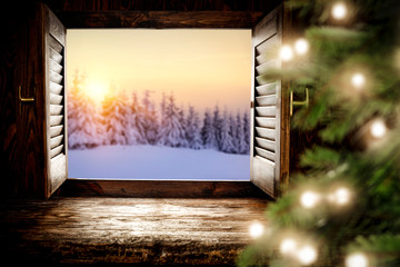 Wooden window sill of free space and christmas time.Xmas tree with lights and decmber landscape.