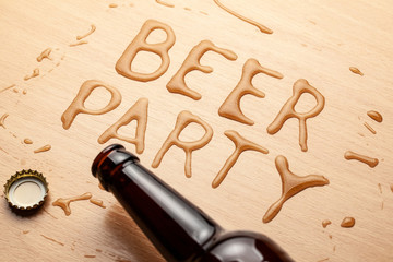 Beer party. A bottle of beer and a spilled drink