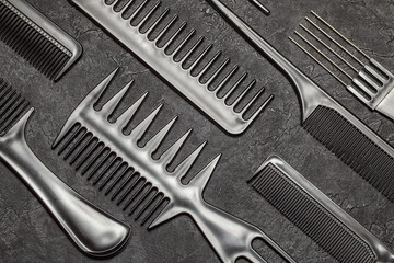Black combs and combs on a black background.