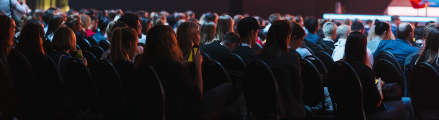 header cover page of Rear view of Audience listening Speakers on the stage in the conference hall...