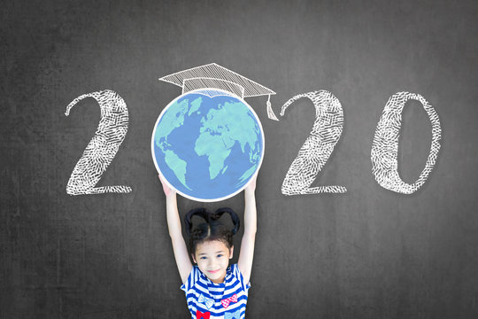 2020 new educational academic calendar year for school class with student kid raising world global planet on teacher's black chalkboard for back to school celebration, classroom schedule