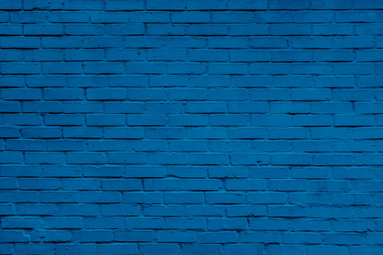 Classic blue brick wall texture close up. Top view. Modern brick wall wallpaper design for web or graphic art projects.