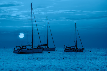 Beautiful evening blue Adriatic sea, yachts and early morning sky, Croatia. Evening seascape. Trendy Banner with color of the year 2020